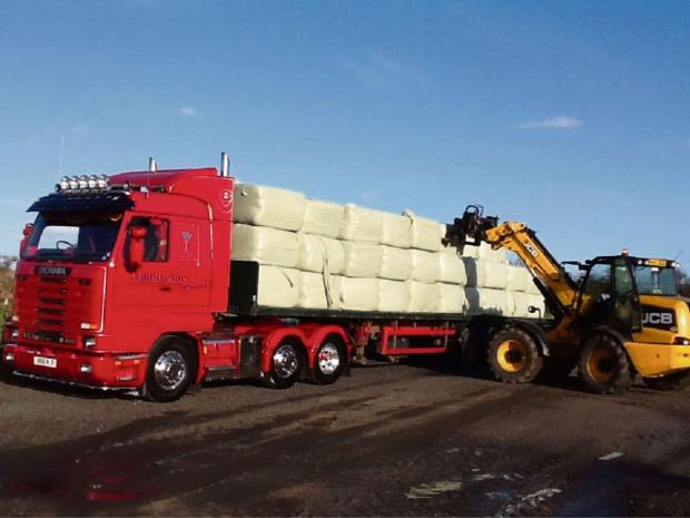 The bales of hay being loaded for delivery to the Somerset Levels
