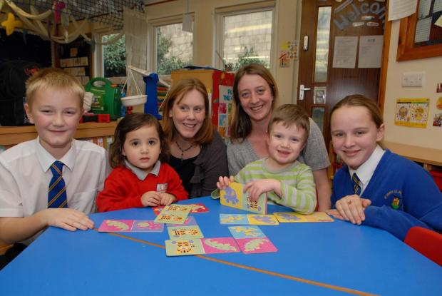 0614512701 Paul Jackson 03.02.14 Broadway St Mary''s RC Primary School has merged with the on site preschool, Little Friends of St Mary's. From left - Max Barnes, 11, Imogen Mendoza, three, Sarah Munn, head of school, Rachel Richards, pre scho
