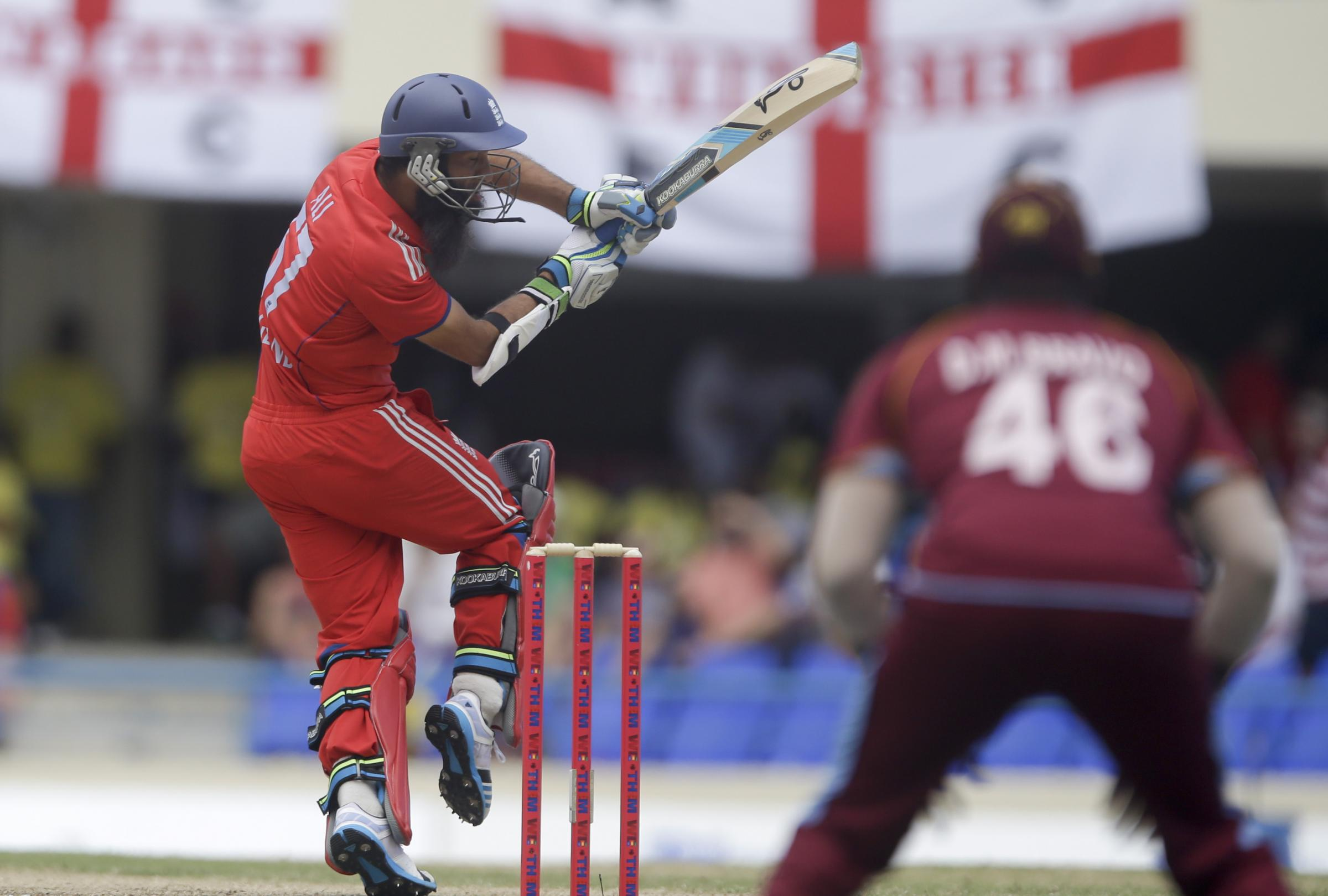England's Moeen Ali bats during the second one-day international cricket match against West Indies at the Sir Vivian Richards Cricket Ground in St. John's, Antigua, Sunday, March 2, 2014. (AP Photo/Ricardo Mazalan). (4340592)