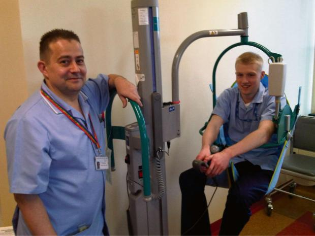 Cotswold Journal: Sam Aldridge from Worcestershire Health and Care NHS Trust being hoisted by colleague Simon Bates