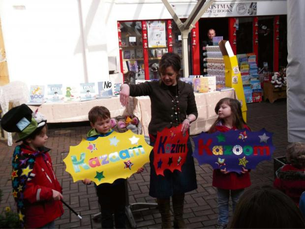 Author Tracey Corderoy teaching magic to some of the children