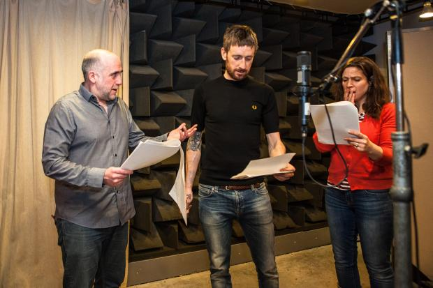 Cotswold Journal: Stephen Kennedy (plays Ian Craig) and Joanna van Kampen (Fallon Rogers) with Olympic gold medalist and Tour de France winning cyclist Sir Bradley Wiggins (centre), who is to guest star in BBC Radio 4's The Archers on Friday 21st March, in a special
