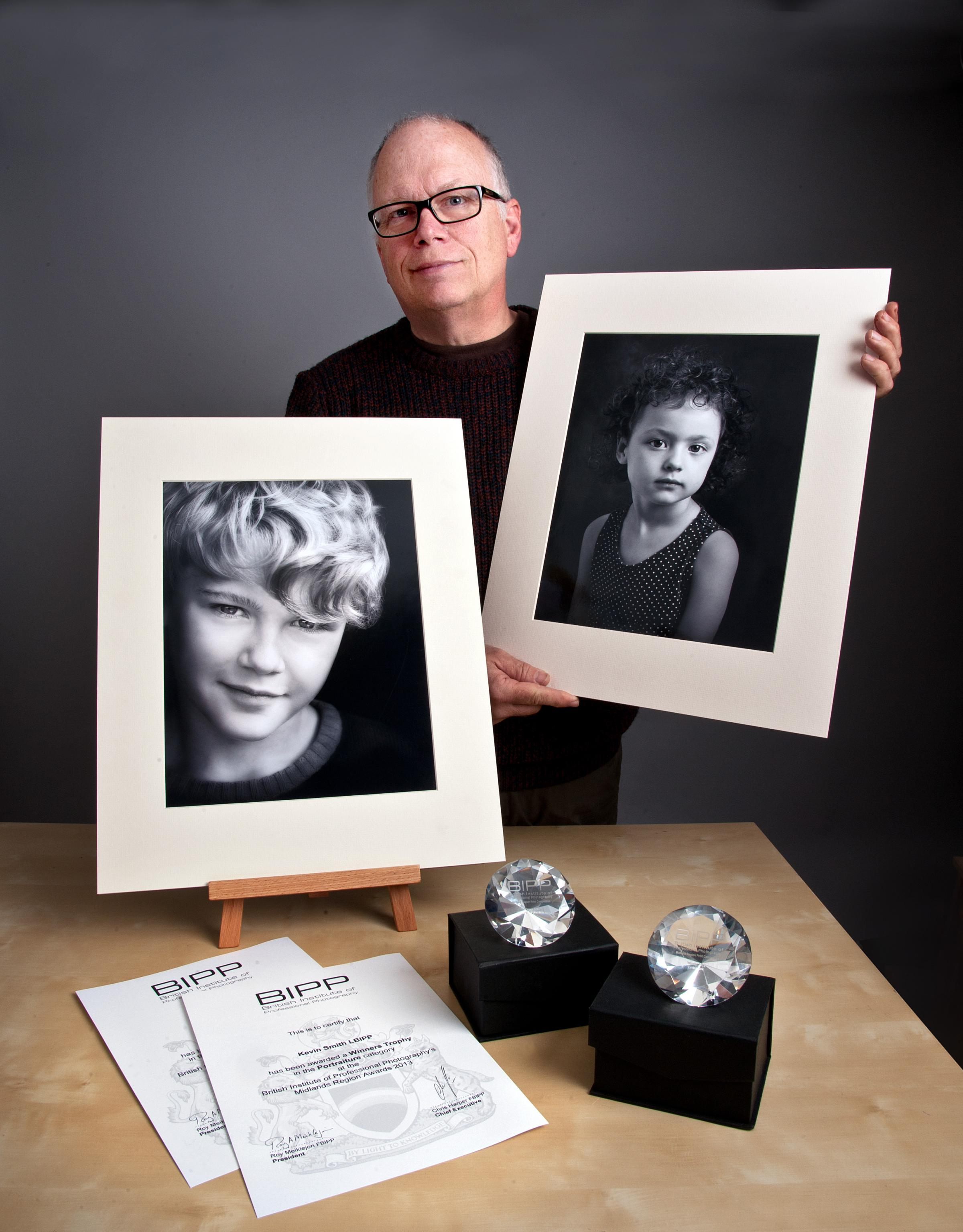 Kevin Smith with his winning images and trophies.