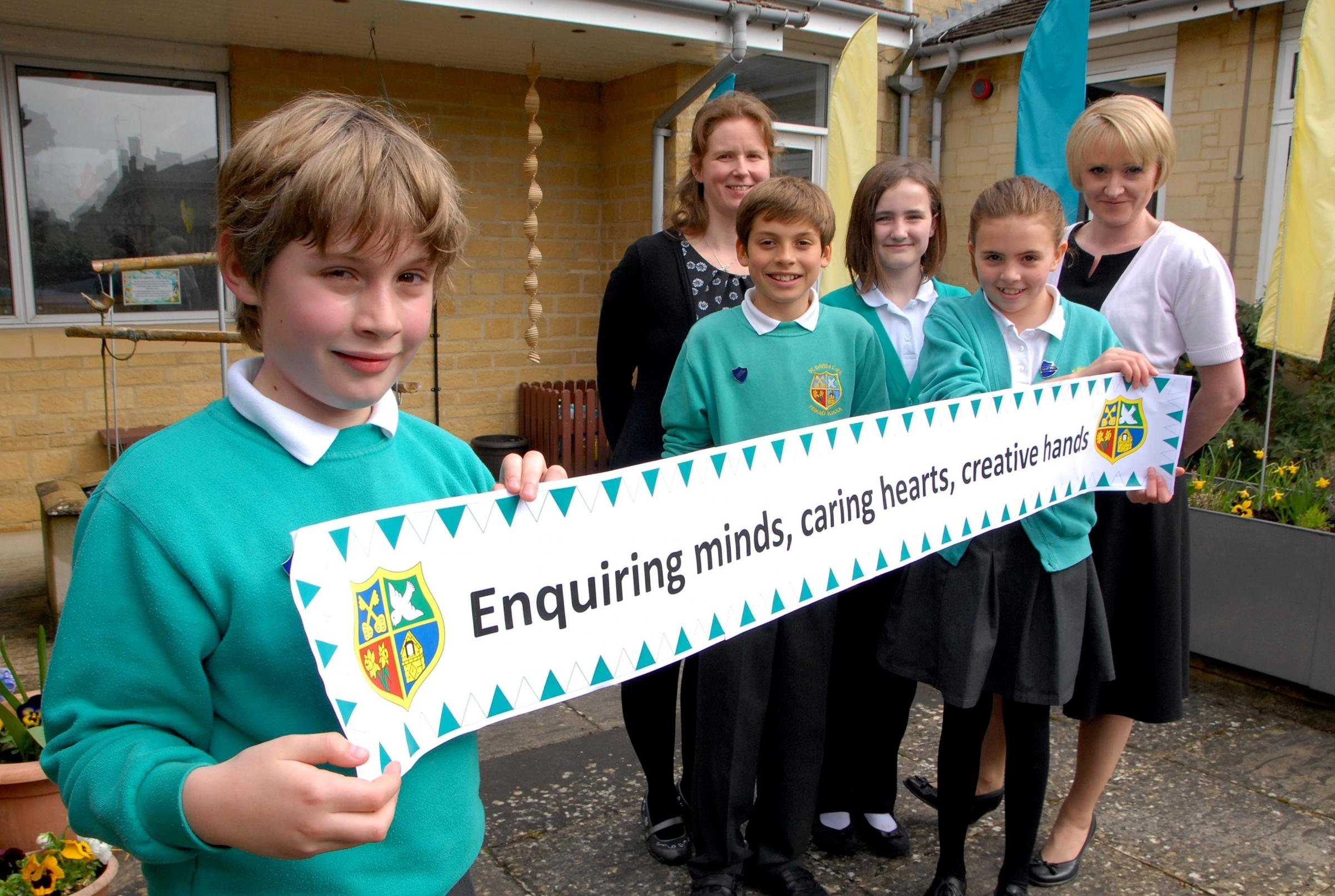 1414561901 Paul Jackson 01.04.14 Moreton-in-Marsh St David's C of E Primary School have a new school motto, Enquiring minds, Caring hearts, creative hands. From left - Dylan Yeomans, ten, Karen Harding, Alfie Townley, 11, Libby Payne, 11,Martha Robbin