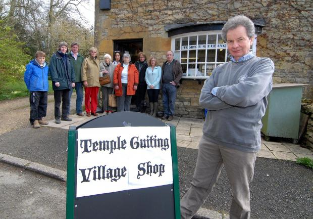 The village shop in Temple Guiting is closing down after 10 years because they can't get a long enough lease or afford to build a new shop. Shop committee chairman David Shepherd Cross, right, with unhappy shop staff and villagers. Picture by Nick Toogoo