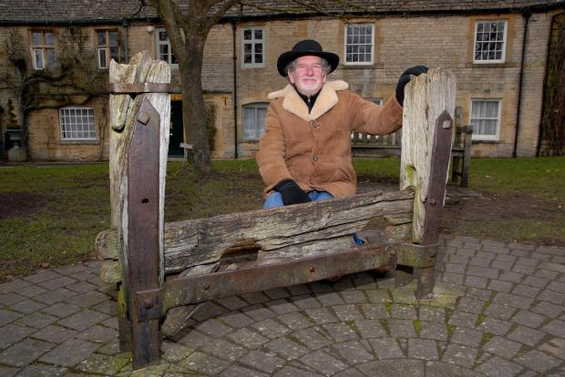Mayor Alun White pictured with the stocks last year. Picture by Paul Jackson.