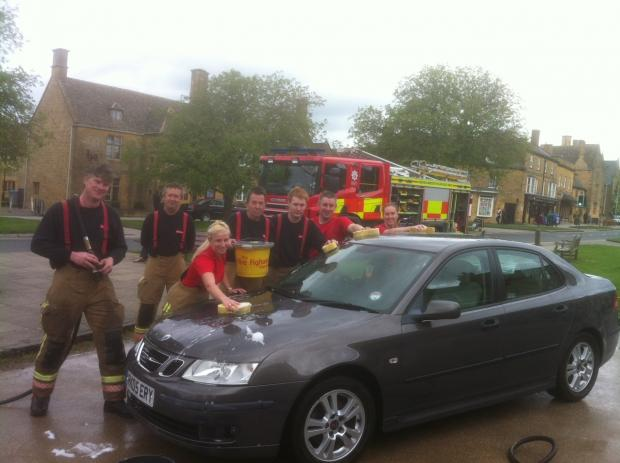 Broadway firefighters get busy washing cars at their charity event this weekend.