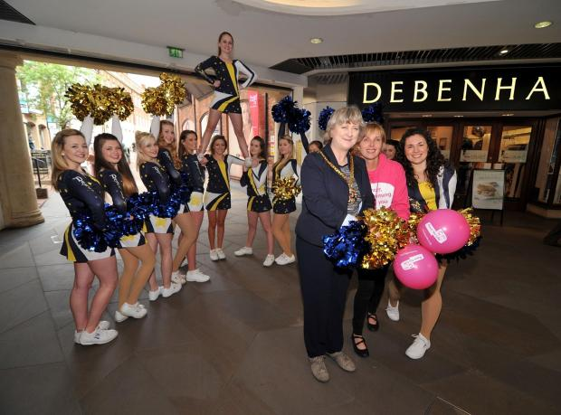 1714582601. 26/04/14. Mayor of Worcester Councillor Pat Agar, Cancer Research UK events manager Michelle Leighton and Gemma Hinton from Dance in Motion with the rest of the cheerleading team launch this years' Worcester Race for Life. Picture by Nick