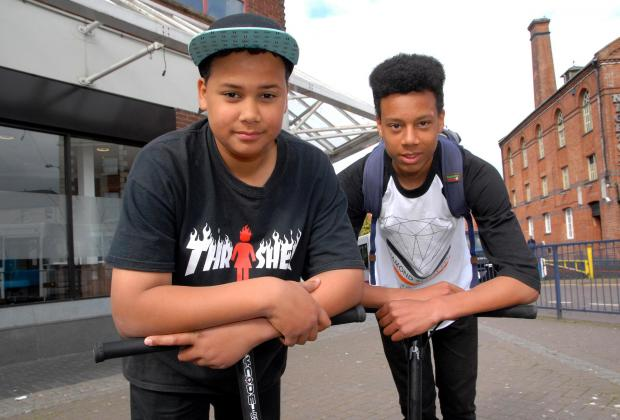 BUS BAN: Charlie Webb, 13 (left) and brother Henry, 15, were refused entry to a Perdiswell park and ride bus because they had their scooters with them. Picture by Paul Jackson, 1614577402