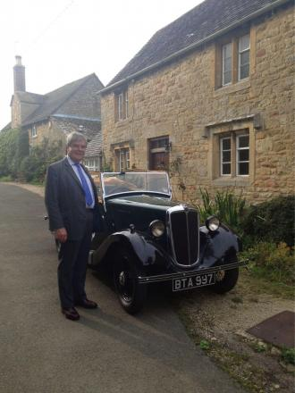 Chipping Campden Estate agent, Mark Annett, with is 1934 Morris 8 Tourer, Isabelle.