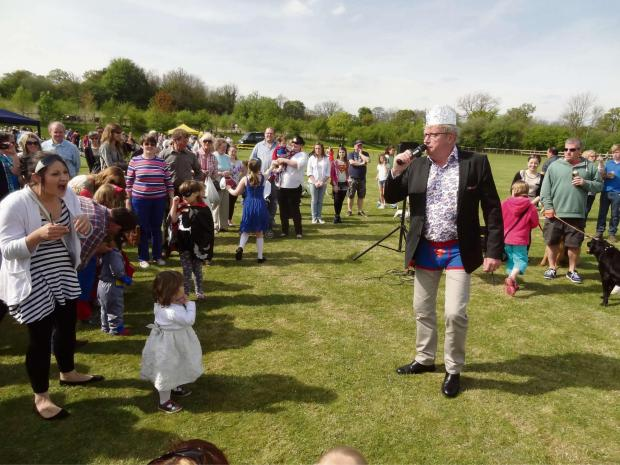 Actor Mark Williams judging the fancy dress competition in Blockley during the May Day celebrations