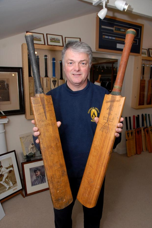 Cotswold Journal: 1914592301 Paul Jackson 06.05.14 Stow-on-the-Wold Andy Collier, owner and curator of Cotswold Cricket Museum with two bats from a tour by Austrailia. He had bought the Warren Bardsley black handled bat from Ebay and the Herbie Collins brown handled bat wa