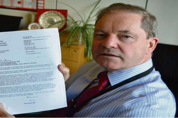 Cotswold MP Geoffrey Clifton-Brown with the letter he received from MP Nick Boles
