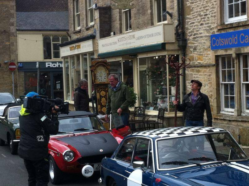 MOTORING MADNESS: James May, Jeremy Clarkson and Richard Hammond filming for Top Gear with their classic cars in Stow. Picture by Gabby Clarke, 11, of Stow Primary School.