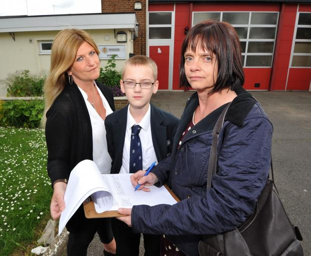 FIGHT: People in Shipston are petitioning to save the town's Young Firefighters Assoc-iation. From left, Donna Hall, her son Matthew and Kate Billing.