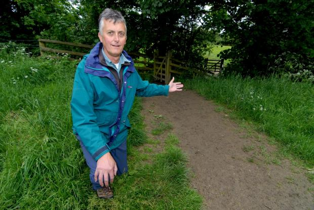 Cotswold Journal: Robert Talbot next to the footpath in Winchcombe that it set to get a £24,000 make-over starting next month. Picture by Nick Toogood. (6582244)