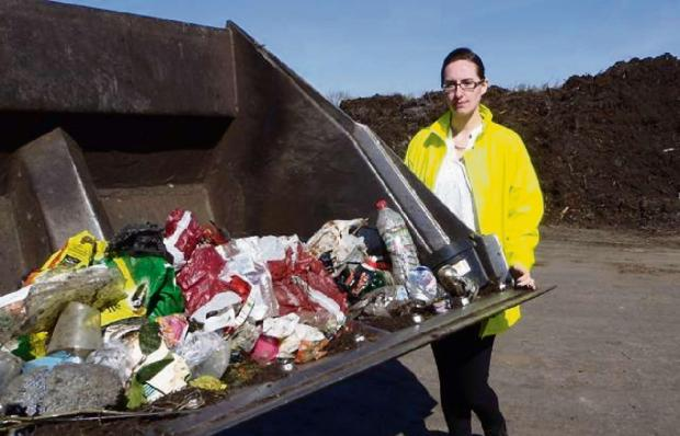 Sian Stokes, Waste and Recycling Officer, at the Agrivert composting site, near Chipping Norton, with contaminated items picked out of one vehicle after collecting garden waste.