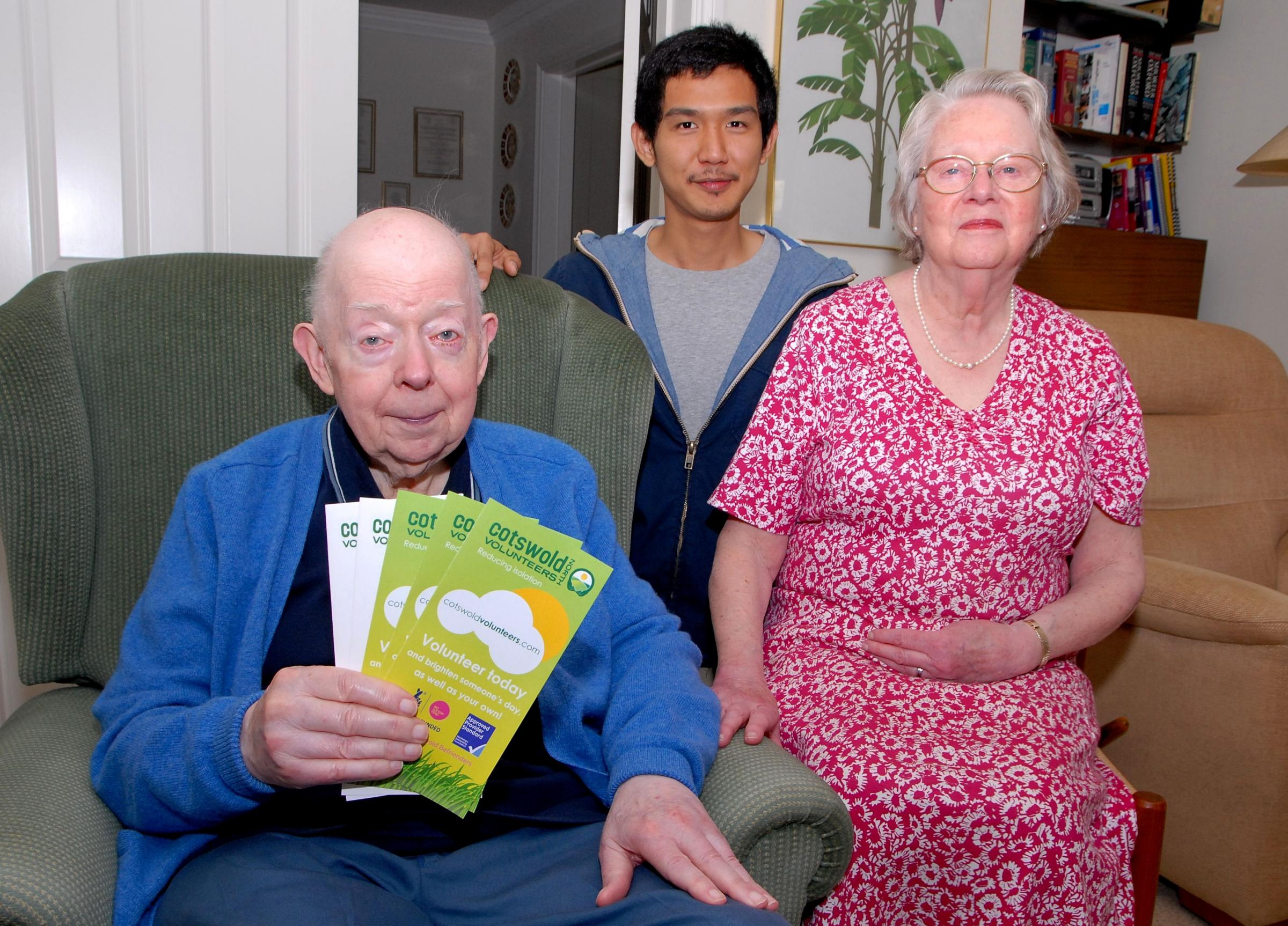 APPEAL: From left, John Hope, Hendry Lo and Margaret Hope. Cotswold Volunteers North are looking for more volunteers, Hendry helps Margaret with John.