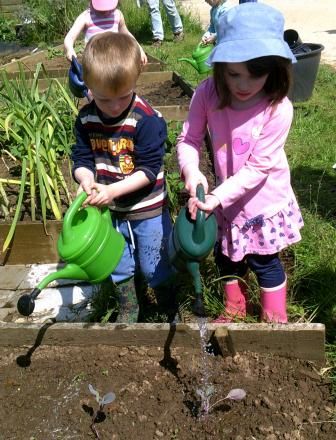 Winchcombe Farm Day Nursery Preschool children, Jeremy George, and Phoebe Herbert, both aged three, taking part in gardening club.