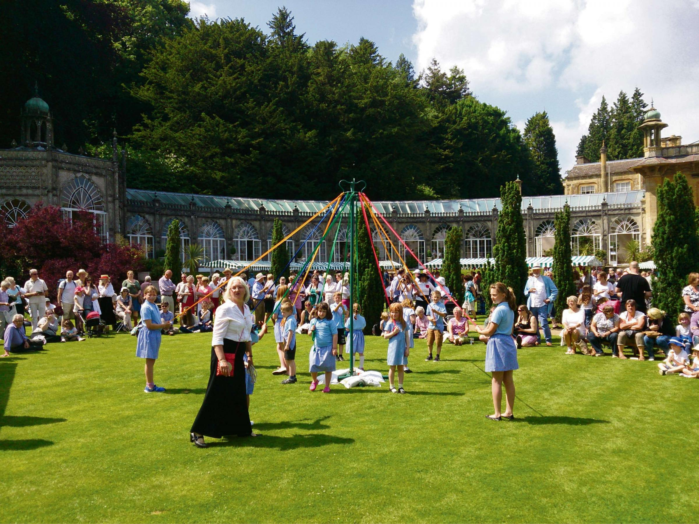 Children from Longborough Primary dancing round the Maypole with Marion Henshaw (front).