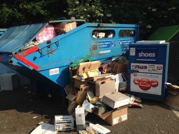 OVERFLOWING: The council is calling for Tesco to clean up its recycling banks in the Cotswolds.