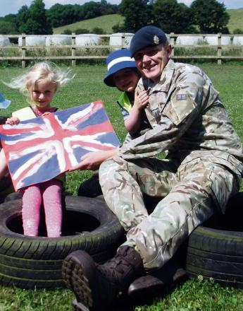 Holly Clifford and Noah Cleaver, both aged 4, from Winchcombe Farm Day Nursery's Preschool who presented Corporal Kevin Doyle with a thank you card for visiting them on Armed Forces Day.