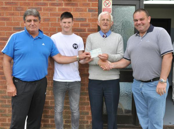 From left: Andy Robbins (Littleton manager), Joe Lolley, Colin Emms (Littleton chairman) and Ken Rae (Kidderminster chairman). Emms received a cheque from Rae as a donation for developing Lolley, who Harriers sold to Huddersfield. Picture: MICHAEL PITTS