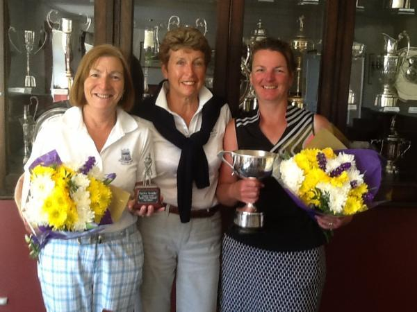 Cotswold Journal: TROPHY WINNERS: Naunton Downs ladies' club champion Dawn Rimmer (right) with Barbara Watson (left), who managed the best nett score, and their captain Carol Park. Picture: VERONICA COURTNEY.