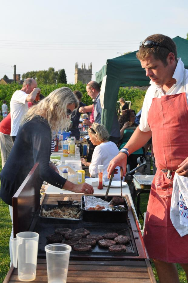 Cotswold Journal: The barbecue did a roaring trade at Longborough School. Picture by Howard Driver.