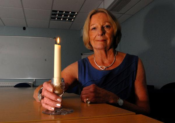 TURN OUT THE LIGHTS: Cllr Carole Topple with a candle to raise awareness of the Lights Out initiative marking the centenary of the war. Picture by Paul Jackson.
