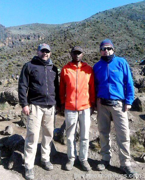 STEEP CHALLENGE: From left - Steve Dennis, Private Expeditions guide Ronald Mamuya and Alan Guthrie heading up Kilimanjaro.