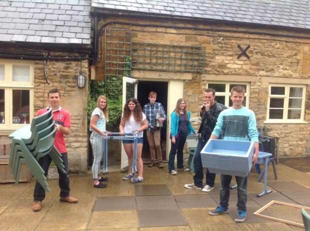 HELPING HAND: Former pupils of Dormer House School rolled up their sleeves to help get classrooms ready for the new school term.