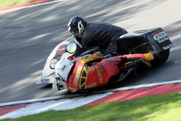CLINGING ON: Passenger Mark Sayers works hard to keep the chair wheel down on a left-hand corner in the British Motorcycle Racing Club Formula Two Sidecars Championship. Picture: RACING LINE PHOTOGRAPHY.