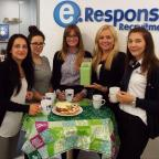 Cotswold Journal: GETTING READY: Some of the eResponse team preparing for the World's Biggest Coffee Morning: Inna Shipley, Jennifer Ingram, Stacey Campion, Lina Jadlauskaite and Jessica Brooks