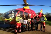 Beryl and Dan Reddington (fourth and fifth from left) from Reddington's Rare Records with Midlands Air Ambulance aircrew.