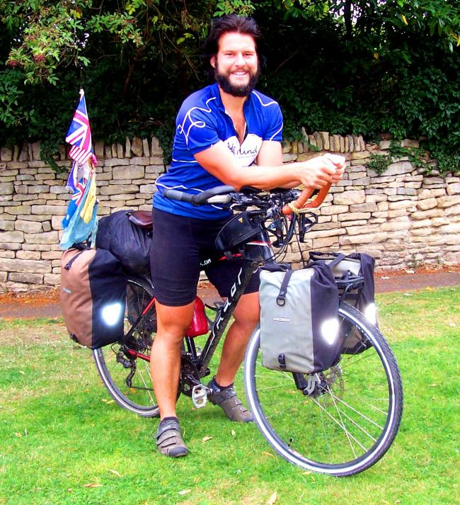 Moreton man returns from round the world cycle ride