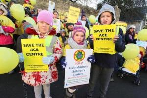 Families take children's centre closure fears to the streets