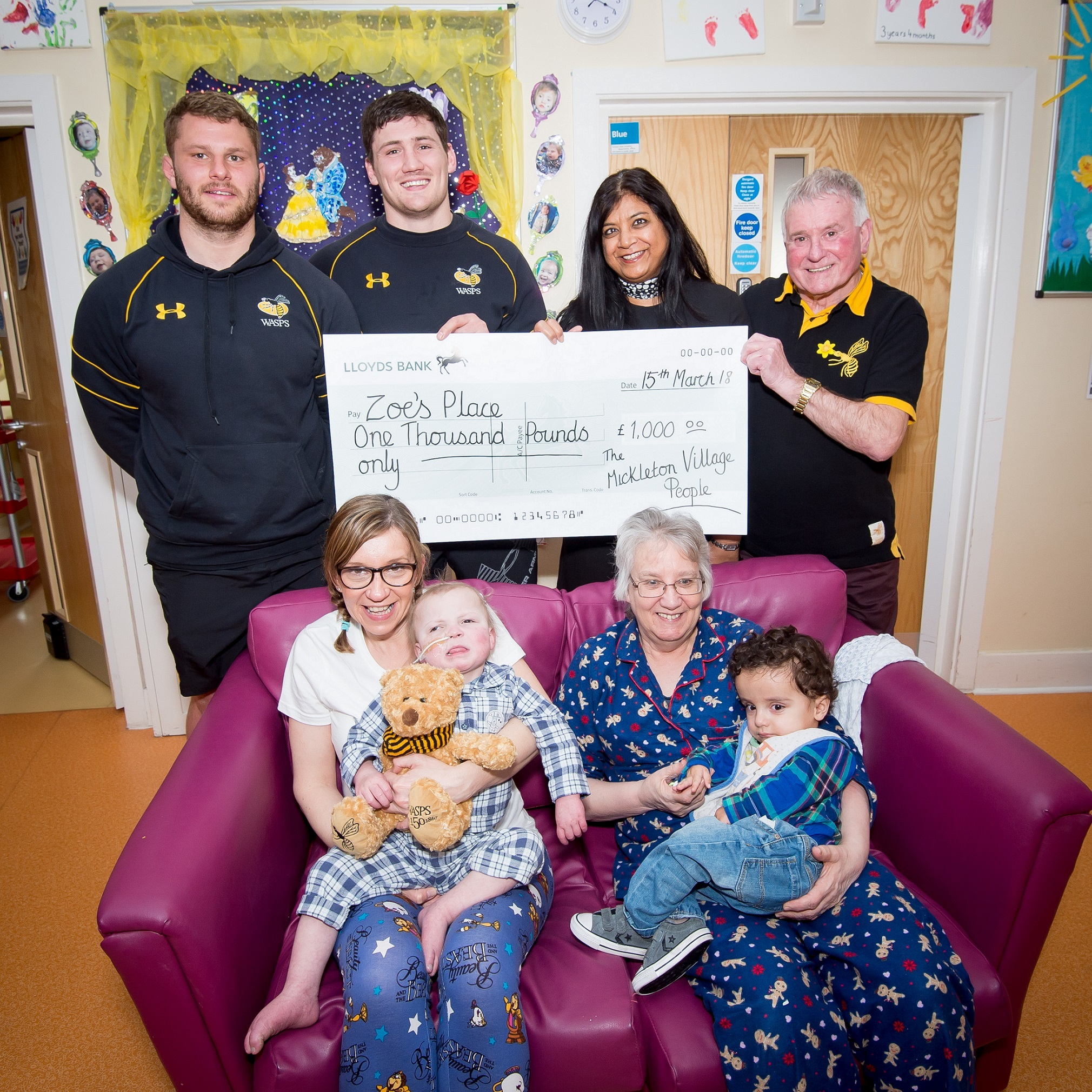 FUNDRAISER: From left, Wasps first team players Thomas Young and Guy Thompson with Muna Chauhan and David Gilbert