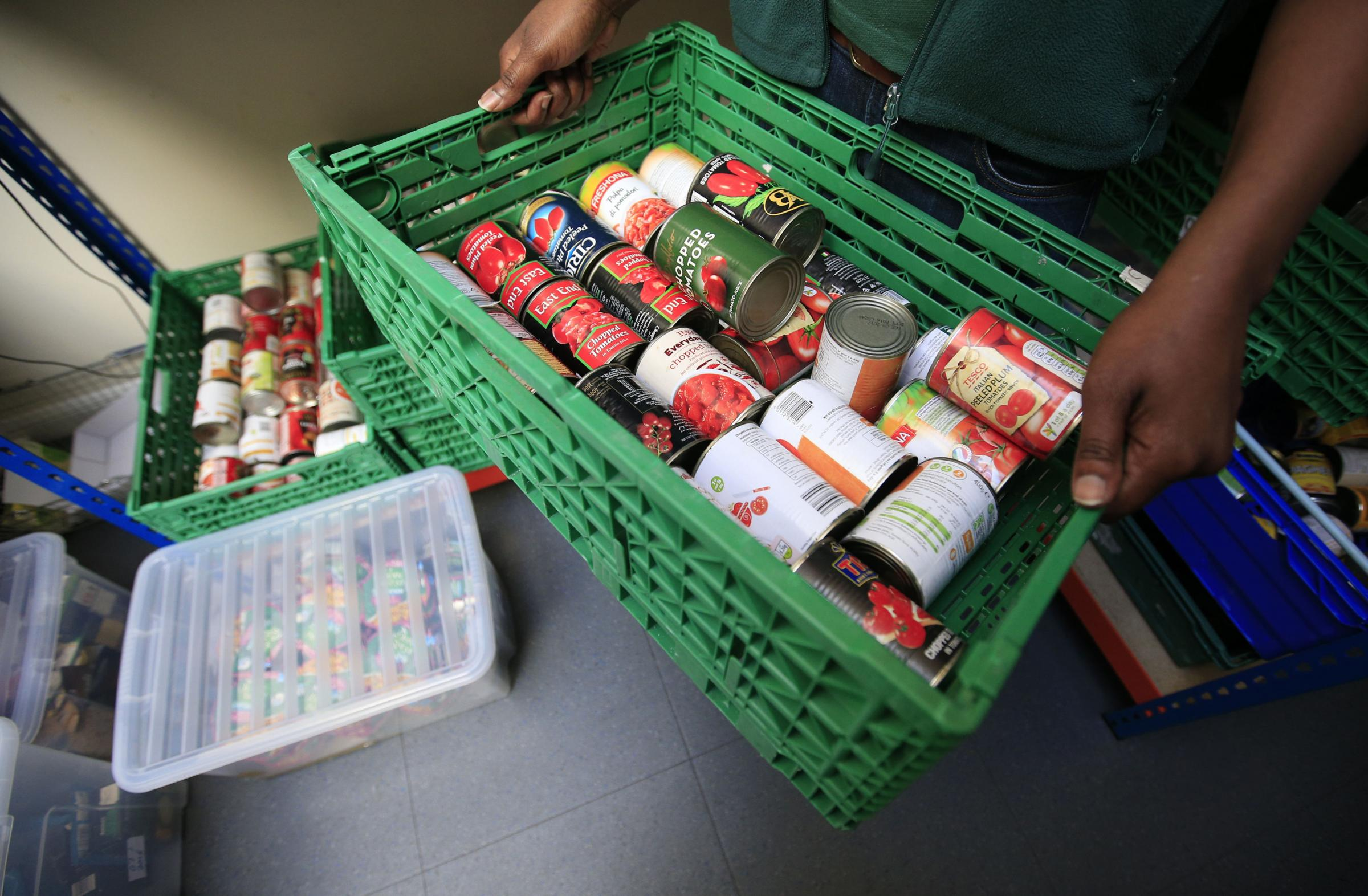 Embargoed to 0001 Thursday October 27..File photo dated 26/04/16 of tins of food at a foodbank, as a study suggests that there is a strong link between increased benefit sanctions and higher foodbank use. PRESS ASSOCIATION Photo. Issue date: Thursday Octo