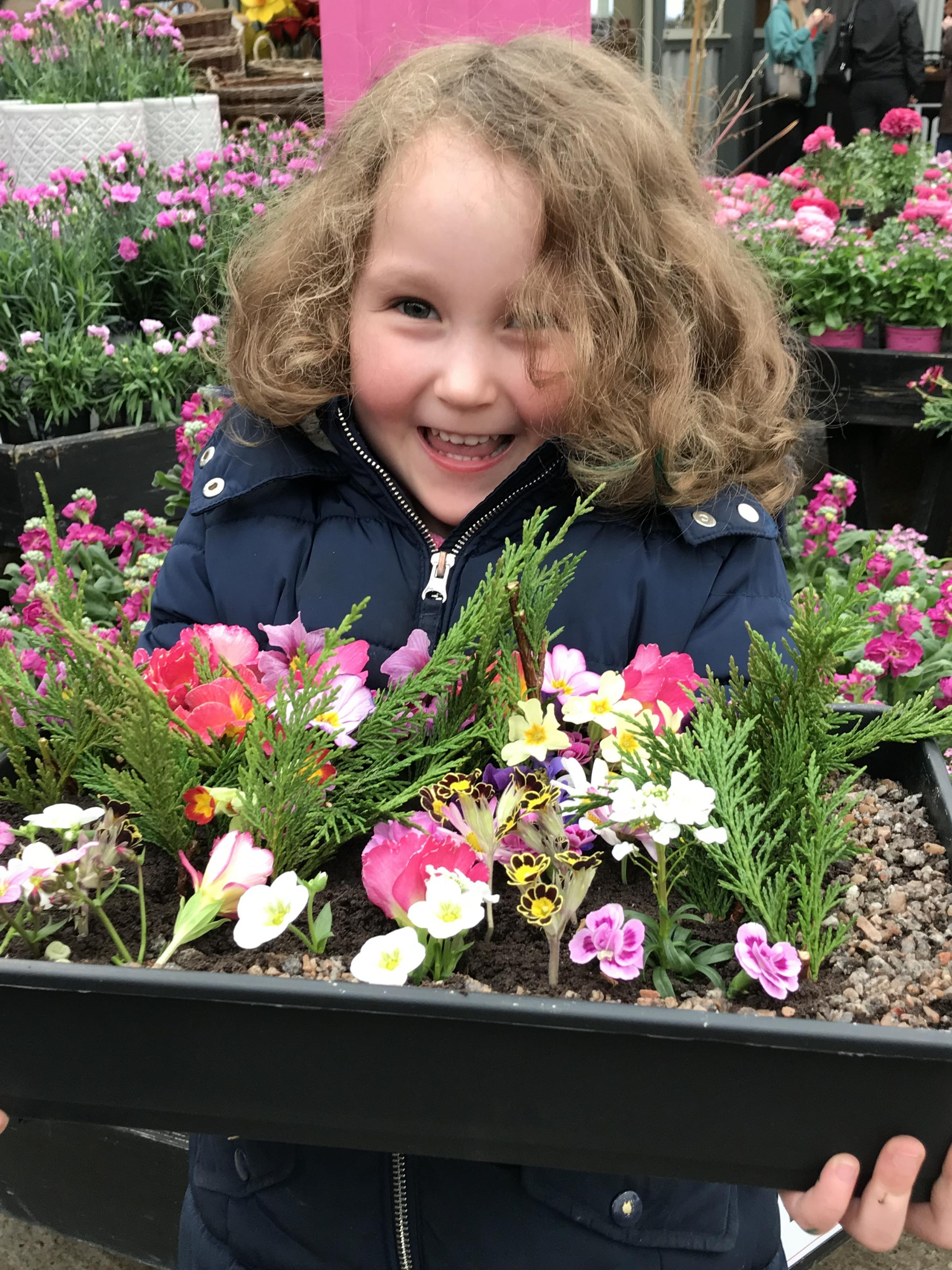 Showing off her own garden in a tray is five year-old Martha Gaffon from Reading, who was visiting her grandmother, Mrs Patricia Marchant from Moreton in Marsh.
