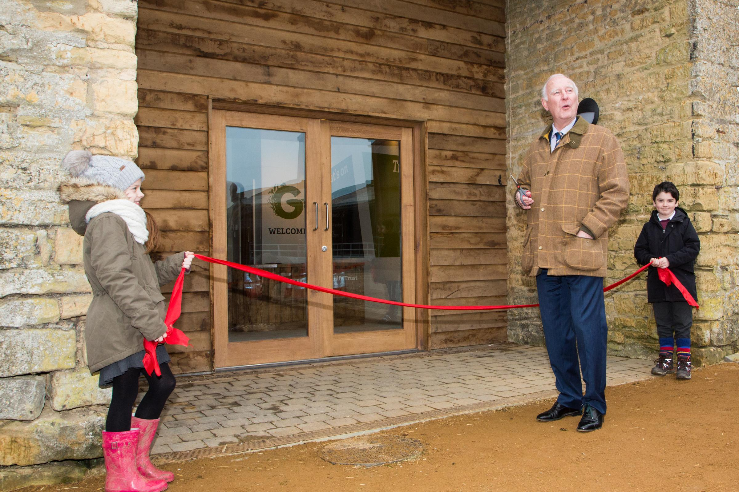 OPEN: Norman Grundon cutting the ribbon.