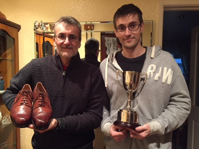 WINNER: Chris Thorne from Bill Bird Shoes with his trophy alongside his dad Mick, who is holding the winning shoes that were made to accommodate his medical condition.