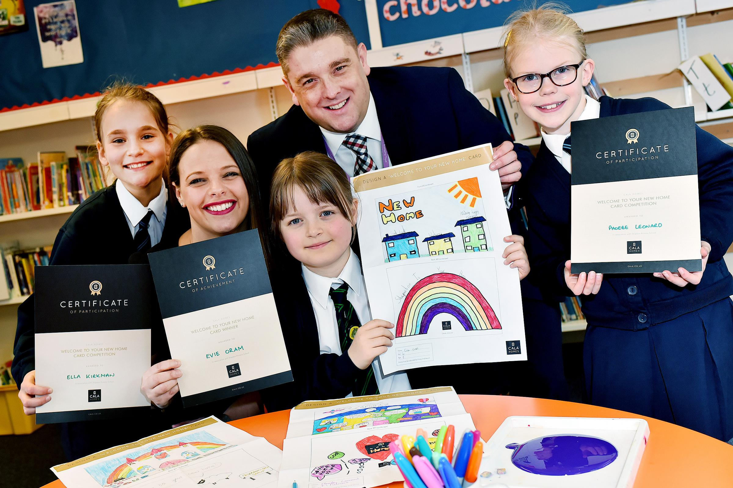 WINNERS: Prizes presented by Hannah Bailey from CALA Homes with Headteacher, Christian Hilton. Winner Evie Oram aged 9 (centre) and runners up, Ella Kirkman aged 10 and Phoebe Leonard, aged 8.