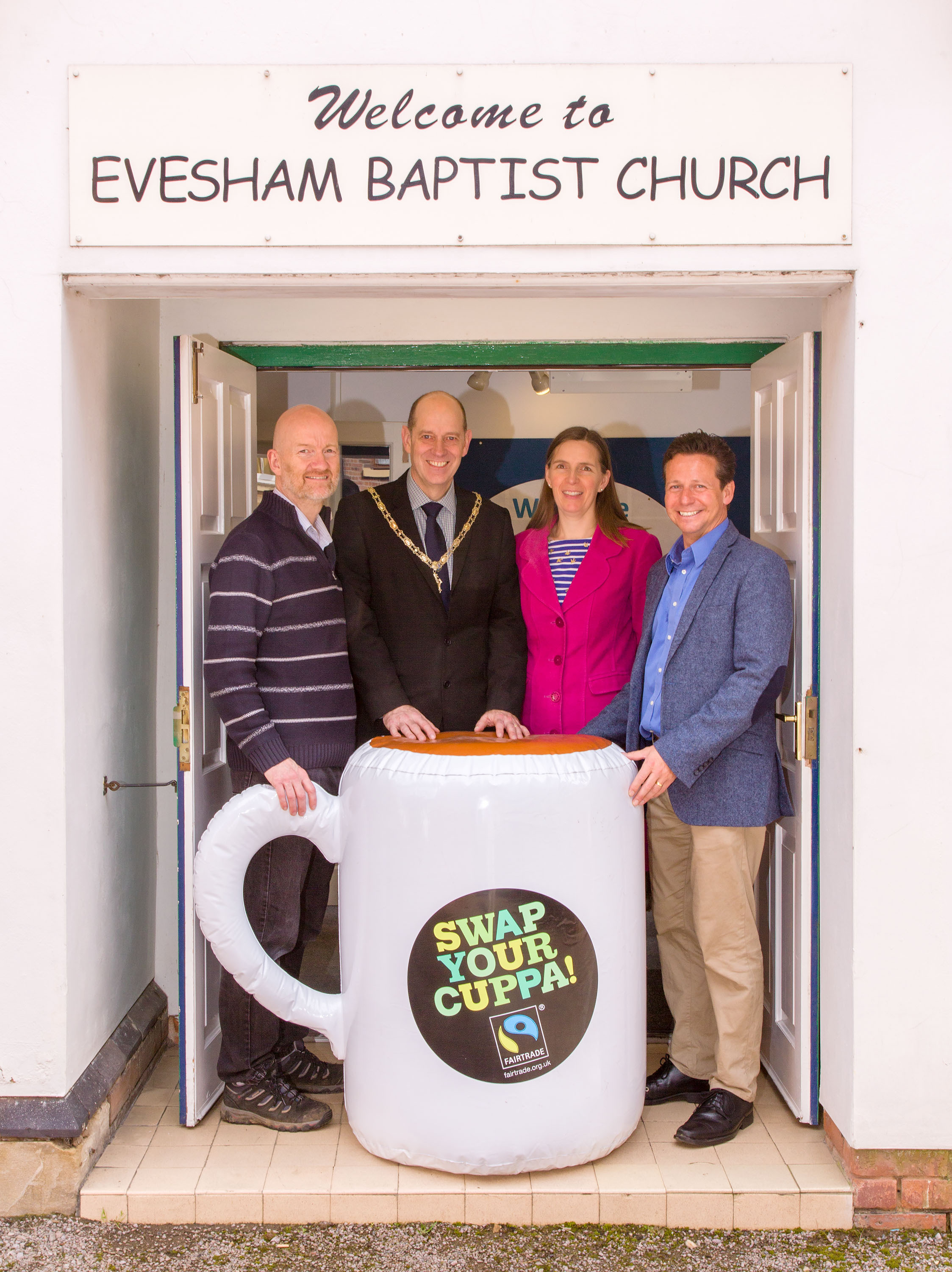 Rev. Dr. Edward Pillar, Councillor Richard Jones and Mrs Penny Jones, Mayor and Mayoress of Evesham, with Nigel Huddleston MP, at Evesham Baptist Church's Fairtrade Pancake Morning, 14th April 2018.Photo credit: Photograph by Simon Brown, Evesham Bapt