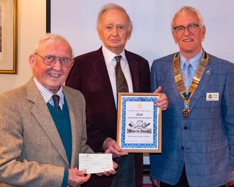 AWARD: From left: Bourton Shedders Pryce Watkins and Howard Crook, with Peter Boxall, with their Community Service Award