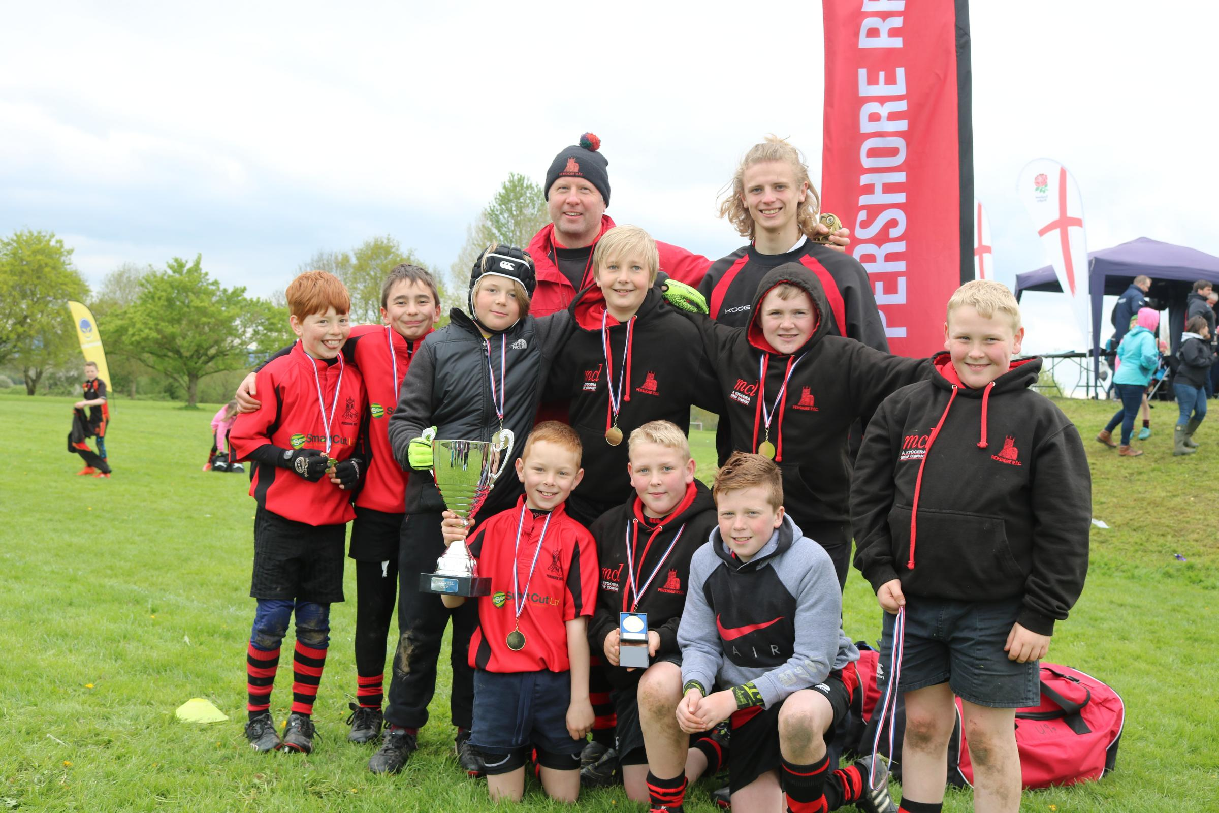 WINNERS: Coaches Ben and Calum Andrews with Pershore's under-11s with the Banwell Cup at the Upton Festival
