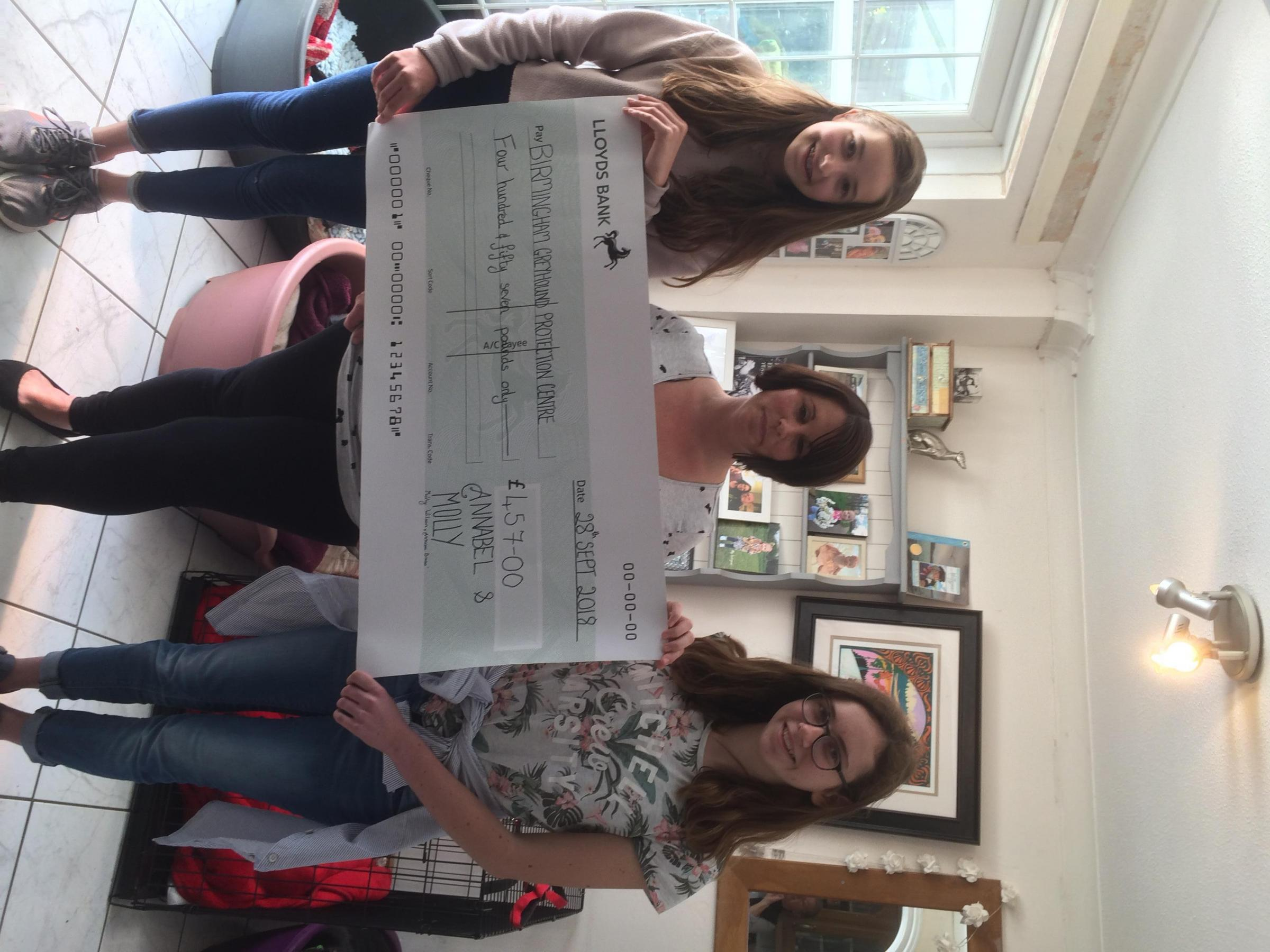 PROUD: The cheque for £457 was presented to Kerry Elliman, founder of 'Birmingham Greyhound Protection/Candy Cane Rescue