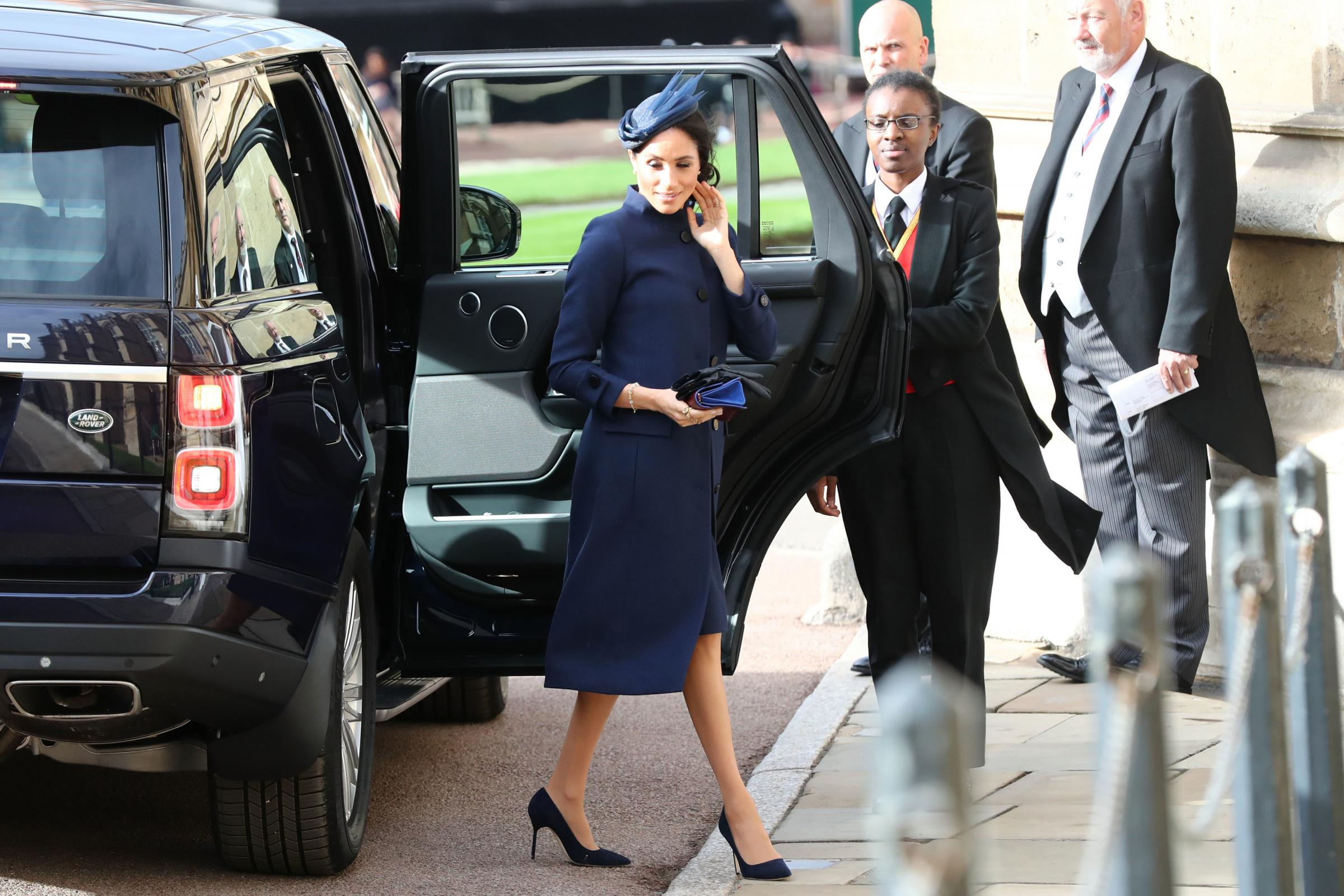 The Duchess of Sussex arrives ahead of the wedding of Princess Eugenie to Jack Brooksbank at St George's Chapel in Windsor Castle. PRESS ASSOCIATION Photo. Picture date: Friday October 12, 2018. See PA story ROYAL Wedding. Photo credit