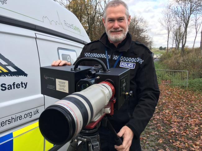 PC Sean Graham with the new long-range camera at the A417. SWBRcamera; Gloucestershire police have revealed a new weapon in their battle against dangerous driving and organised criminals