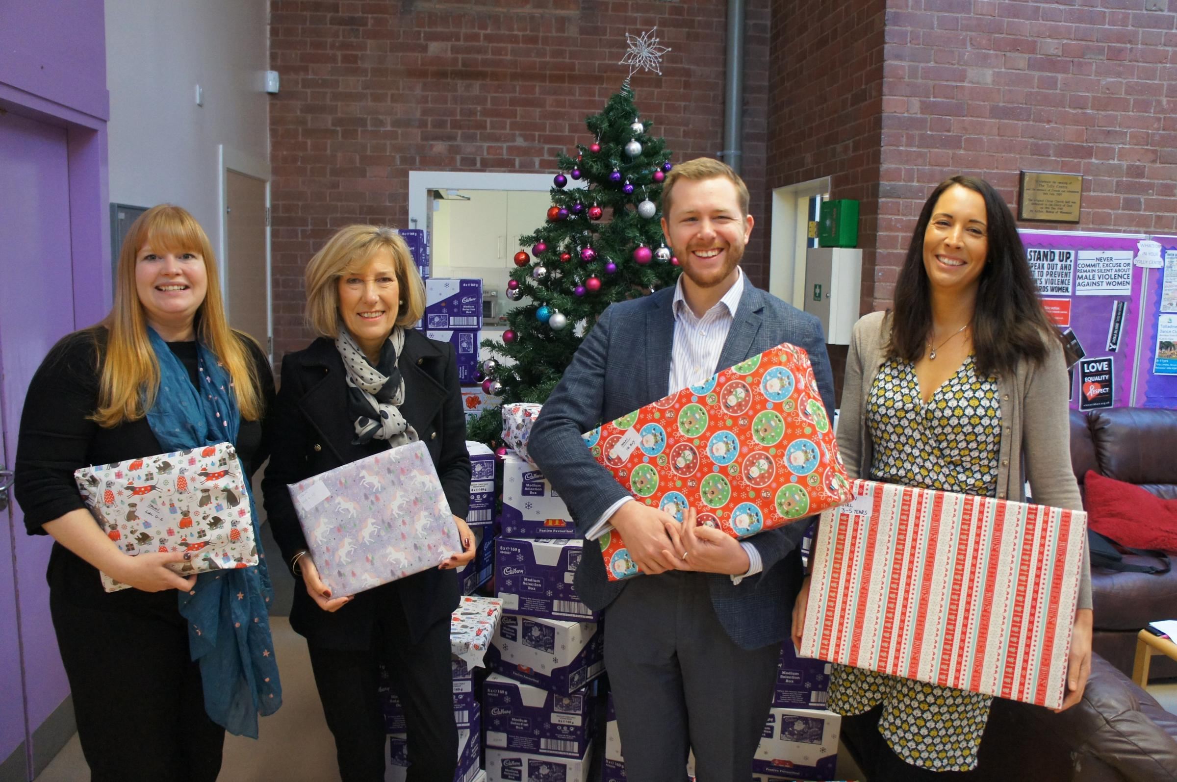 GIFTS: (Left to right) Ruth Sanderson from WCT, Pauline Coombes and Ben Allman from Ballards and Ruth Heywood from WCT
